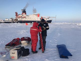 setting up the corer to collect ice core samples on the floe near Polarstern.